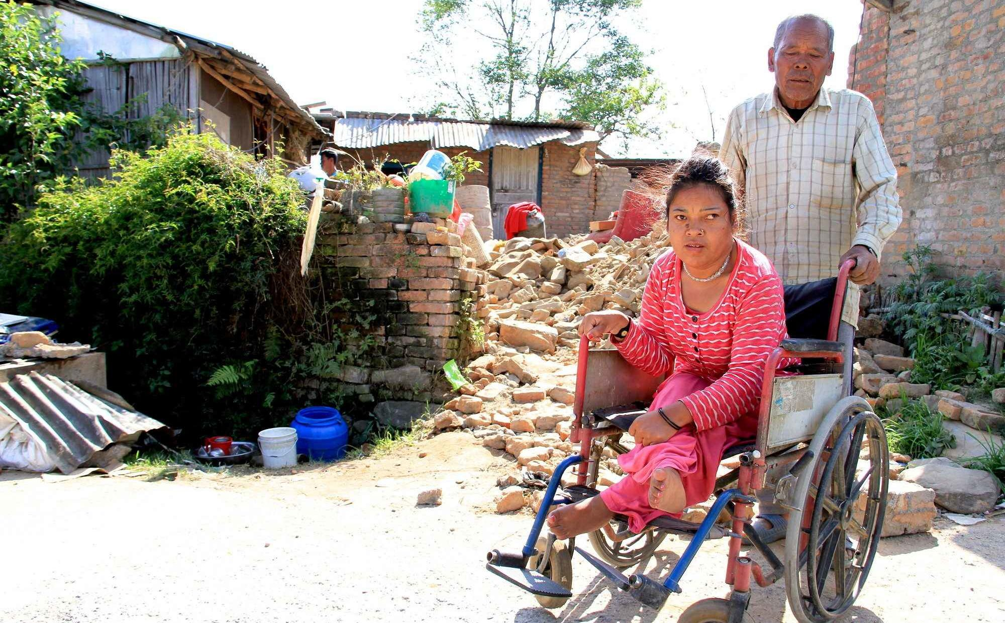 Purna Maya and her father after the 2015 earthquake in Nepal.