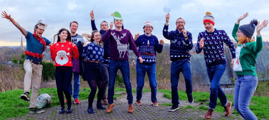 Studio 24 team in Christmas jumpers