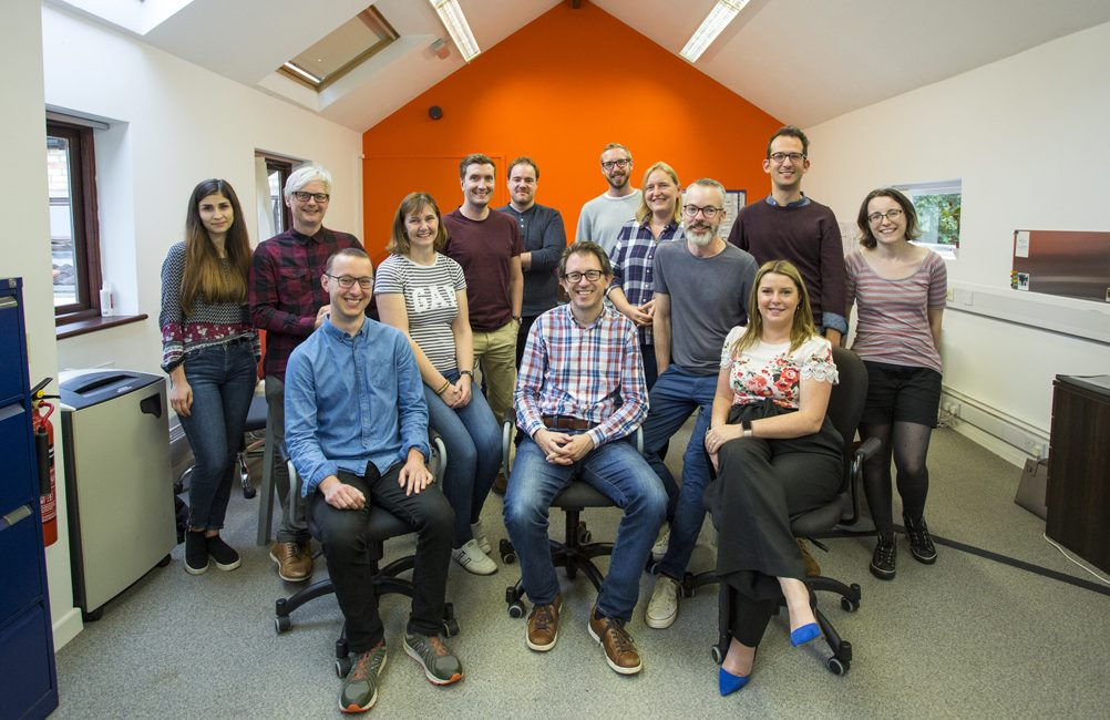 Studio 24 team sitting upstairs in the studio